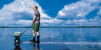 image of man fertilizing the water